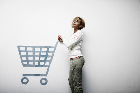 woman shopping cart: Woman pushing shopping cart symbol