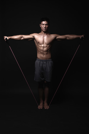 Man exercising with resistance bands photo