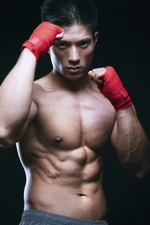bare waist: Man with his punching pose Stock Photo
