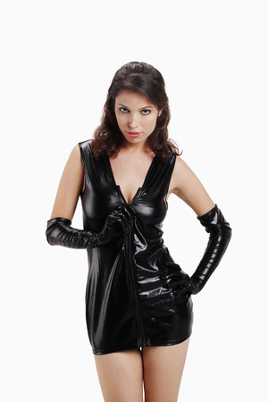 Woman in black vinyl mini dress photo