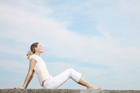 peacefulness: Woman closing her eyes, relaxing