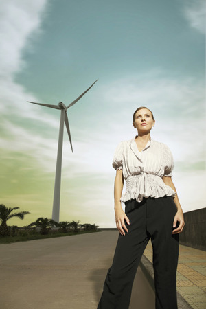 low blouse: Businesswoman standing by the road, looking away Stock Photo