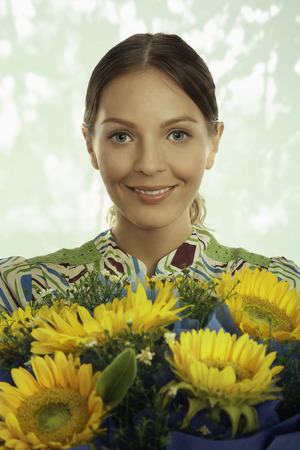 Woman holding a bouquet of sunflowers photo
