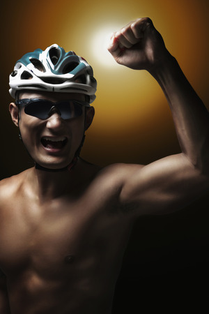 Man in cycling helmet celebrating his success photo