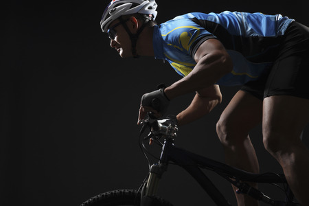 Male cyclist riding on bicycle photo