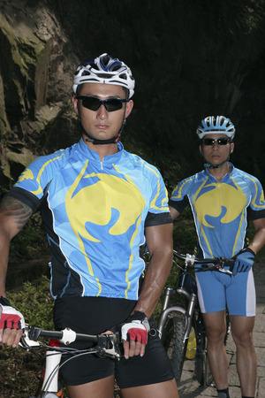 Male cyclists with their bicycles photo