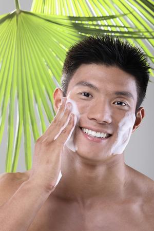 Man washing his face photo