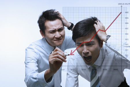 Businessmen watching a declining line graph  photo