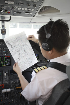 Pilot in private jet cockpit photo