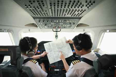 pilot cockpit: Pilot and co-pilot in private jet cockpit
