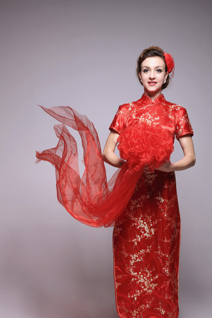 Woman in cheongsam holding organza bouquet