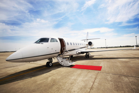 Private airplane with red carpet