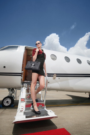 exiting: Woman exiting private jet