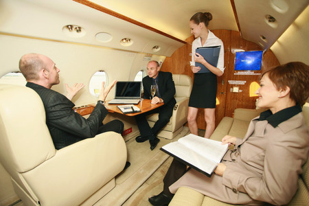 eastern european ethnicity: Business people in a private jet