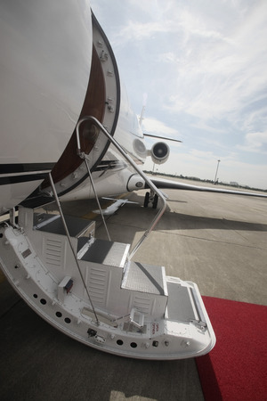Private airplane with red carpet photo