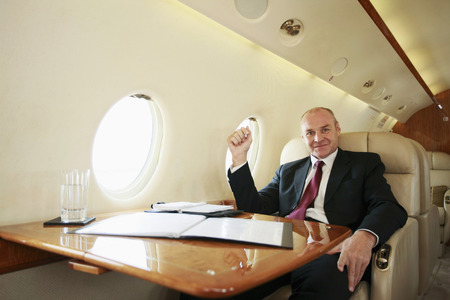 Businessman working in private jet photo