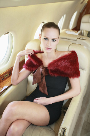 Woman sitting in private jet photo