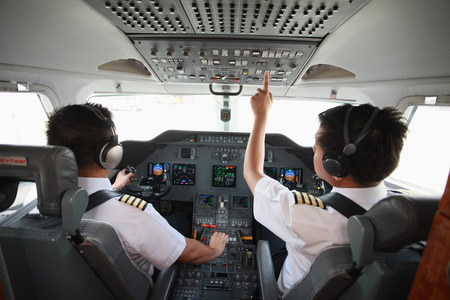 cockpit: Pilot and co-pilot in private jet cockpit