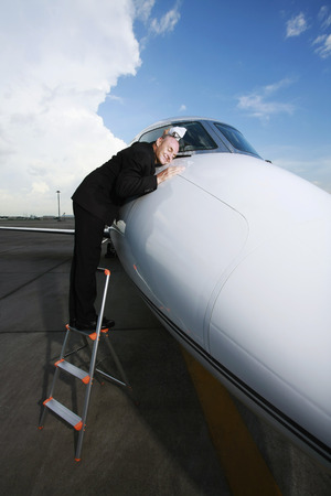 Businessman with face on front of private jet  photo
