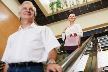 Man and woman on escalator in airport photo