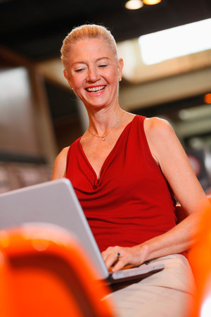 airport lounge: Businesswoman using laptop in airport lounge