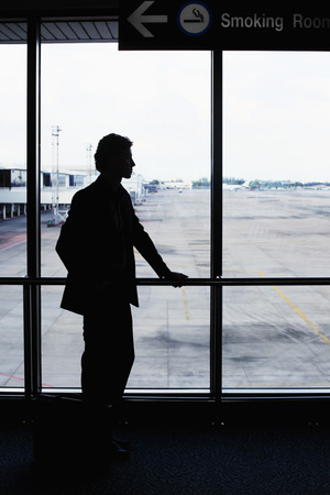 airport lounge: Businessman waiting for his flight in airport lounge Stock Photo