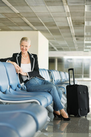 airport lounge: Businesswoman sitting at airport lounge Stock Photo