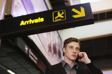 Businessman talking on the phone in the airport photo