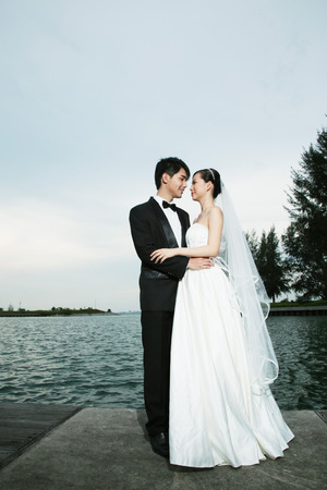 Bride and groom posing outdoors photo