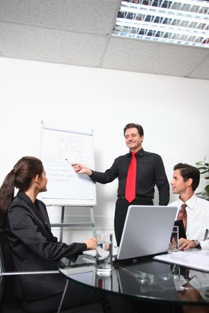 mature mexican: Businessman presenting his ideas in a meeting Stock Photo