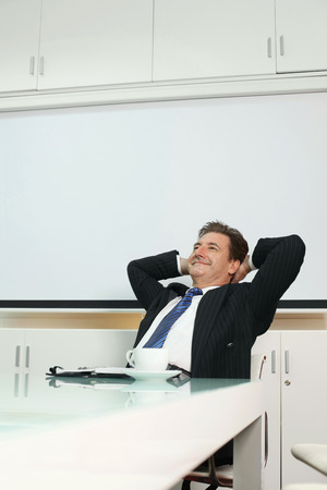 Businessman smiling while daydreaming photo