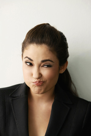 Businesswoman making a face while thinking photo