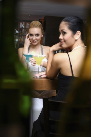 Women drinking at a bar photo