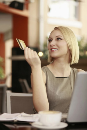 Businesswoman paying with credit card photo
