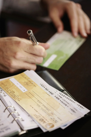 signing authority: Businessman writing on check