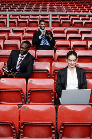south western european descent: Business people in the stadium