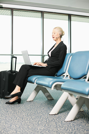 airport lounge: Businesswoman using laptop at airport lounge Stock Photo
