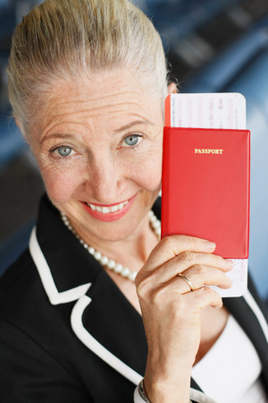 airport lounge: Businesswoman showing her passport in airport lounge Stock Photo