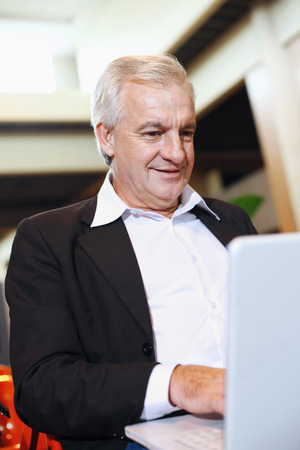 airport lounge: Businessman using laptop in airport lounge