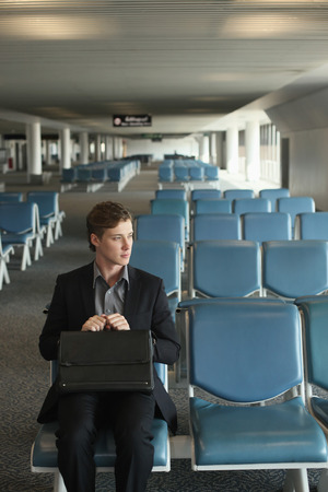 airport lounge: Businessman sitting in airport lounge