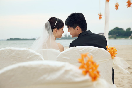 Bride and groom at their beach wedding ceremony photo