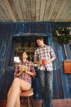 Man and woman with their cups of drink photo