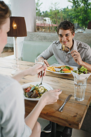 central european ethnicity: Man and woman having lunch together Stock Photo