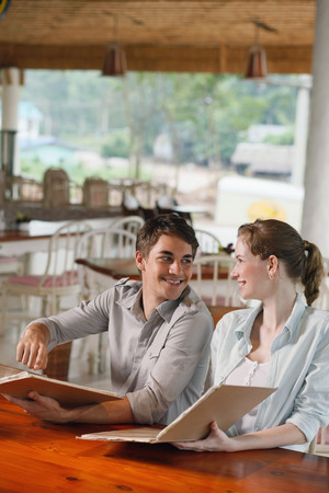 central european ethnicity: Man and woman reading menu in a restaurant Stock Photo