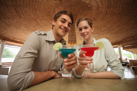 central european ethnicity: Man and woman with their drinks Stock Photo