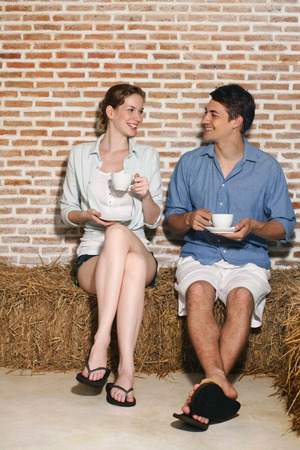 central european ethnicity: Man and woman with their cups of coffee Stock Photo