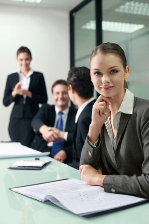 Businesswoman sitting at the conference table photo