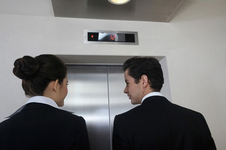 Business people waiting for elevator