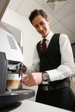 making coffee: Businessman making coffee in the office pantry