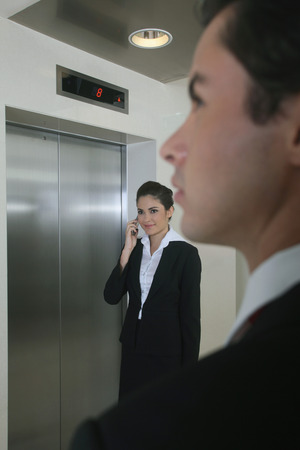 Business people waiting for elevator photo